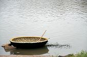 picture of coracle  - Newly built coracle along with row stick - JPG