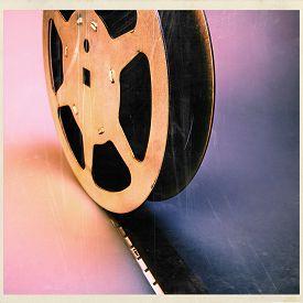 foto of mm  - 16 mm film reel old archive pink blue black - JPG