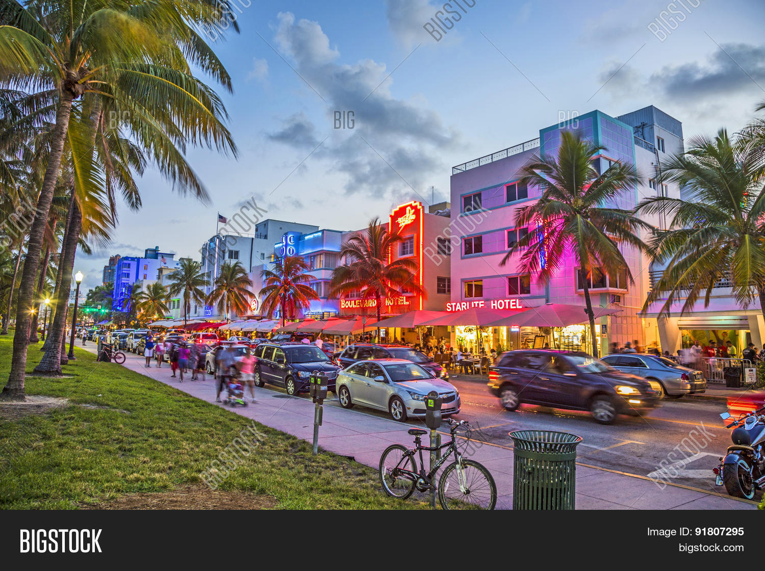Stock Photo People Enjoy Palm Trees And Art Deco Hotels At Ocean Drive on 1500 Ocean Drive Miami Beach