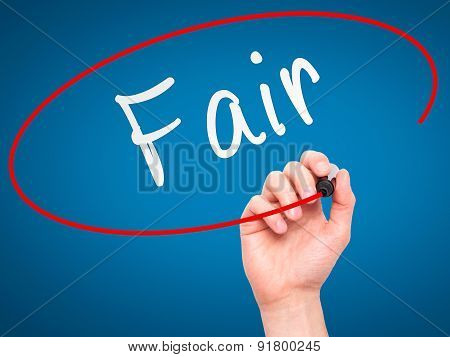 Man Hand writing Fair with black marker on visual screen.