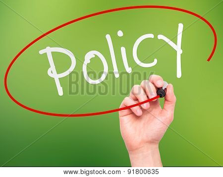 Man Hand writing Policy with marker on transparent wipe board.