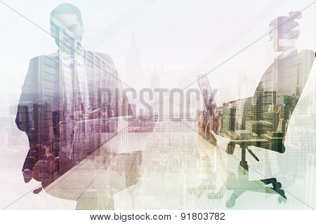 Happy businessman with laptop using smartphone against server room with towers