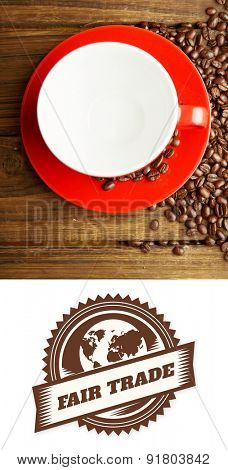 Fair Trade graphic against coffee beans and cup