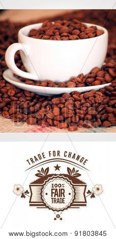 Fair Trade graphic against morning coffee with beans