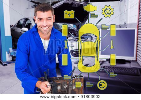 Smiling male machanic repairing car engine against workshop
