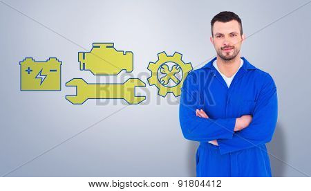 Mechanic standing arms crossed against grey vignette