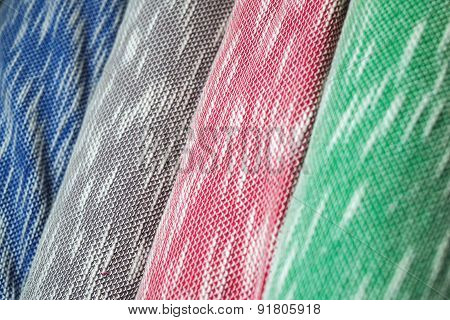 Rolls of colorful fabric as a vibrant background image