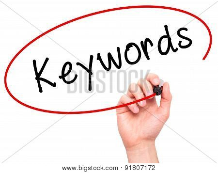 Man hand writing Keywords on visual screen.