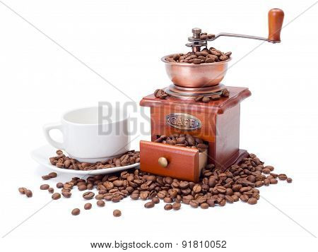 Old Fashioned Coffee Ginder With Cup And Beans