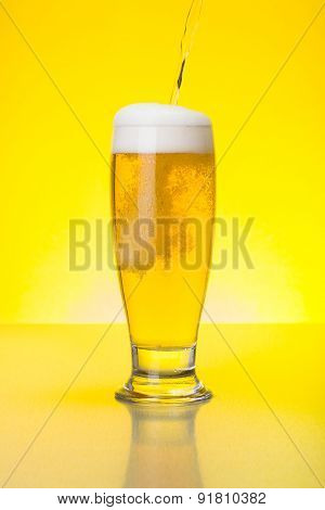 Beer Being Pured Into Glass