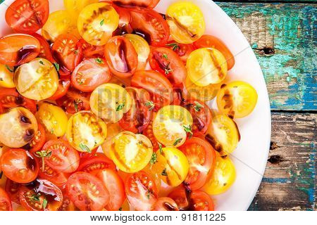 Salad Of Organic Cherry Tomatoes With Olive Oil And Balsamic Sauce Closeup
