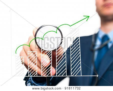 Business man with stethoscope examining graph, business analysis.