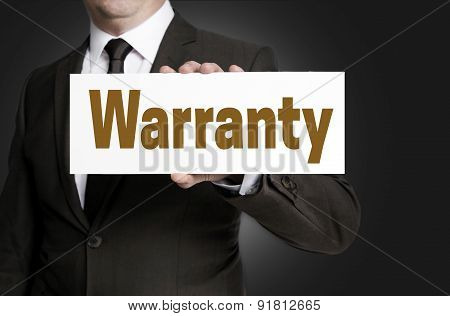 Warranty Sign Is Held By Businessman