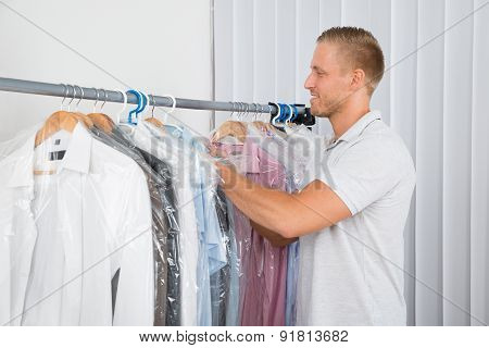 Young Man In Dry Cleaning Store