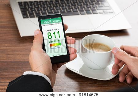 Businessman Checking Credit Score On Cellphone