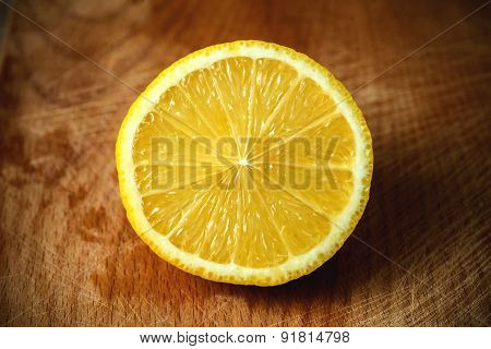 sliced lemon on a cutting board .wooden background