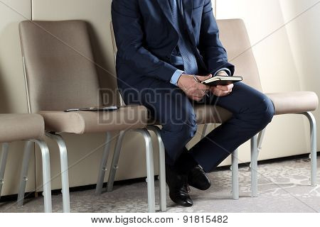 Ready For Interview. Thoughtful Man In Formalwear  Sitting At The Chair In Waiting Room