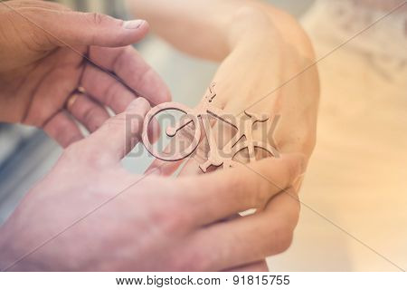 Decorative wooden bicycle ring  on a girl's hand