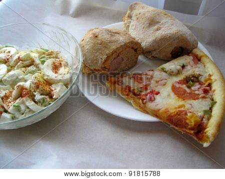 Hot dog wraps salad and pizza