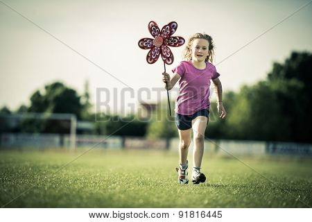 Young girl having fun with a pinwheel