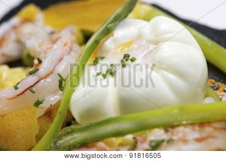Poached egg with saffron risotto and vegetables.