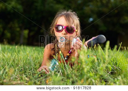The image of a cute little girl with bubbles
