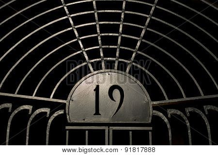 Old Iron Gate With Number 19 On It