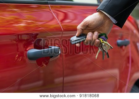Man Opening The Car Door With Remote Control