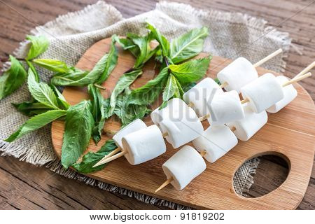Marshmallow Skewers On The Wooden Board