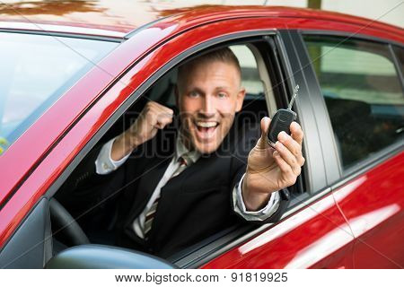 Excited Businessman Showing New Car Key