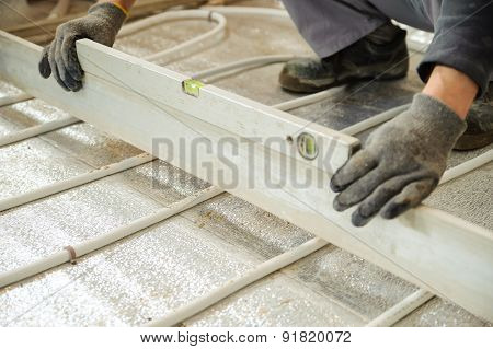 Man Sets Level Concrete Floor