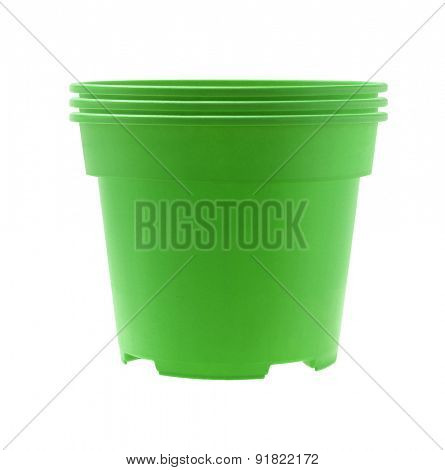 Stack of Green Plastic Flower Pots on White Background