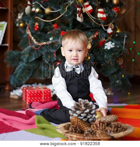 Little Boy In Christmas Decorations Expect A Miracle