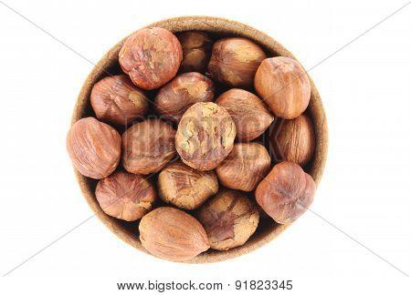 Hazelnut In A Round Wooden Form
