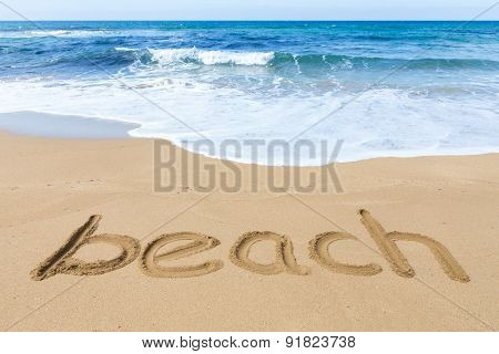 Word beach on sandy coast with blue sea