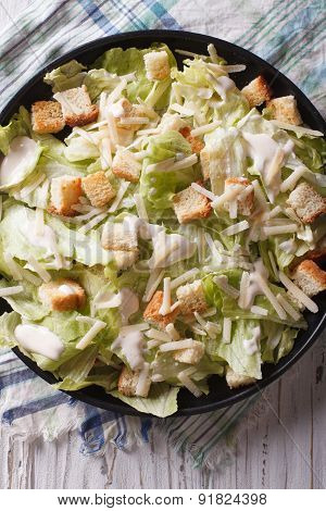 Traditional Caesar Salad Close-up On A Plate. Vertical Top View