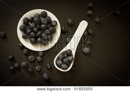 Blueberries With White Ceramic Spoon