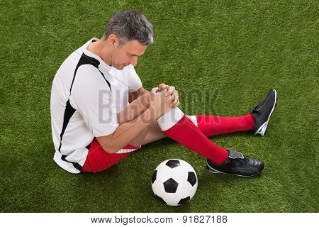 Soccer Player With Injury In Knee