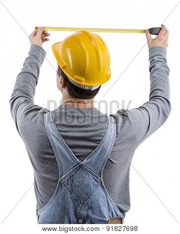 Construction worker measuring the wall over white background.