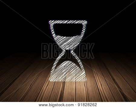 Timeline concept: Hourglass in grunge dark room