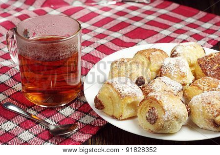 Small Cakes With Raisins And Tea