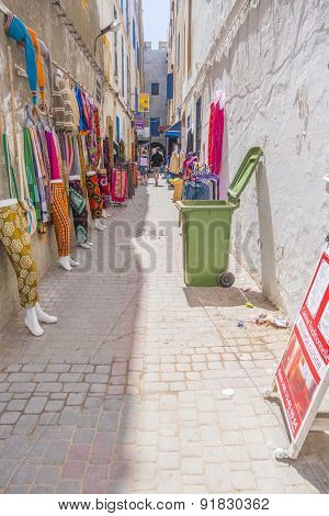 AS-SAWIRA, MOROCCO, APRIL 7, 2015: Commercial street with clothes and souvenirs stores