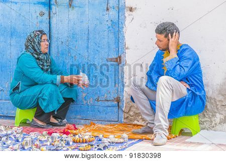 AS-SAWIRA, MOROCCO, APRIL 7, 2015: street sellers of local jewelry chat waiting for buyers