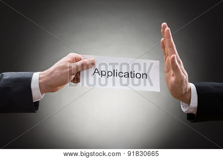 Businessman Avoiding Application Form