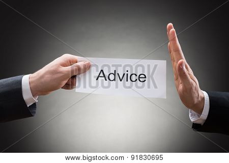 Close-up Of Businessman's Hand Refusing Advice Sign