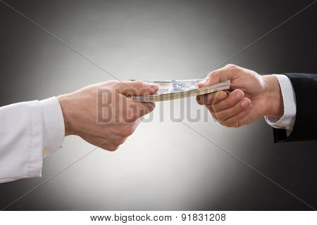Businessman Giving Money To Doctor