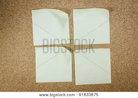 Yellow Stick Note Isolated On Wood Background