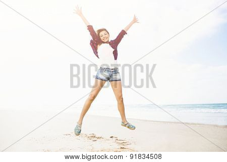 Beautiful and happy girl enjoying the day at the beach