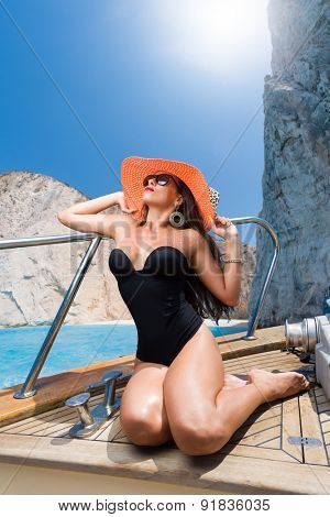 Woman sailing at shipwreck navagio beach in Zakynthos Greece