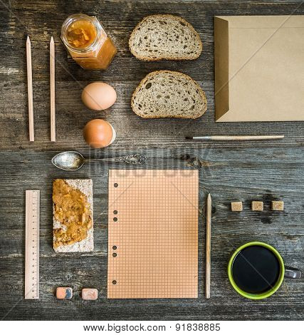 breakfast business person. coffee, sheets of notes and stationery on wooden table. top view